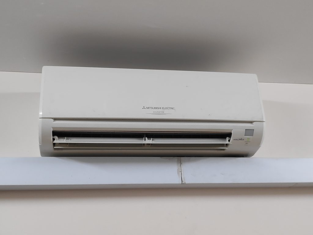 why is my aircon blowing hot air?